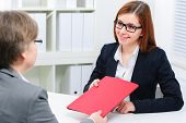 smiling woman having job interviews and receiving portfolios