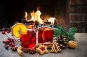 picture of christmas spices  - Delicious mulled wine with christmas decoration at romantic fireplace - JPG