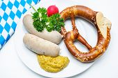 Bavarian meal. White sausages with sweet mustard and pretzels