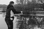 pic of fishermen  - Fisherman on the river bank - JPG