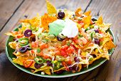 stock photo of nachos  - Plate with fresh Nachos with guacamole sauce - JPG
