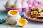foto of duck egg blue  - Series on boiled duck egg for breakfast with toast soldiers  - JPG