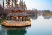 picture of gazebo  - Round traditional Chinese wooden gazebo on the coast of West Lake park in Hangzhou city China - JPG