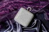 image of clutch  - white clutch inlaid diamonds on silk background - JPG