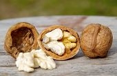 pic of walnut  - Walnut kernels and whole walnuts on wooden table - JPG
