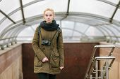 foto of dreadlocks  - Outdoors city portrait of young blonde hipster woman photographer with dreadlocks in scarf and military style olive parka - JPG