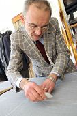 image of tailoring  - Real tailor in a small town near Assisi in Italy - JPG