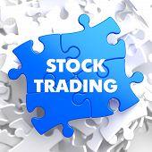 stock photo of debenture  - Stock Trading on Blue Puzzle on White Background - JPG
