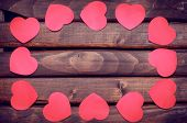 pic of valentines  - Red heart stickers on a dark wooden background - JPG