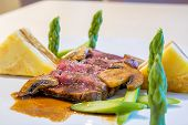 picture of veal  - beef loin off veal with potatoes vegetables mushrooms and mushroom sauce - JPG