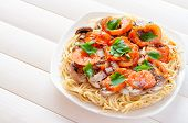 stock photo of spaghetti  - Pizza of spaghetti with tomato and mushrooms - JPG