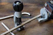 image of bender  - Tube bender or pipe bender tools on wooden background - JPG