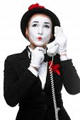 picture of mime  - business woman as mime holding a handset isolated on white background - JPG
