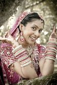 picture of indian beautiful people  - Young beautiful Hindu Indian bride in traditional gown outdoors in garden