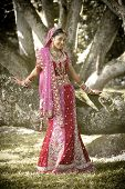 stock photo of indian beautiful people  - Young beautiful Hindu Indian bride in traditional gown outdoors in garden - JPG