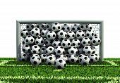goal full of soccer balls