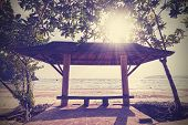 pic of bench  - Retro filtered photo of a seaside bench at sunset - JPG