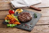 pic of burger  - burger grill with vegetables and sauce on a wooden surface  - JPG