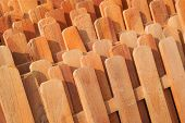 stock photo of wooden fence  - Rows of wooden fences stacked together for sale - JPG