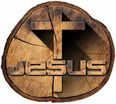 stock photo of jesus  - Wooden Christian cross on a section of tree trunk with text Jesus isolated on white background - JPG