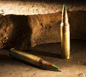 stock photo of piercings  - Ammunition with a green tip some consider capable of piercing body armor - JPG