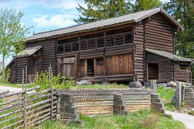 stock photo of shadoof  - typical swedish wooden house  - JPG