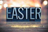 picture of pentecostal  - The word EASTER written in vintage metal letterpress type on a soft backlit background - JPG