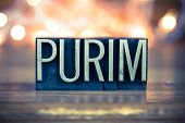 pic of purim  - The word PURIM written in vintage metal letterpress type on a soft backlit background - JPG