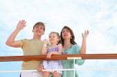 Mom Dad And Daughter Wave By Hands To Ship