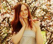 foto of sakura  - Happy young woman in spring flowers garden lifestyle portrait - JPG