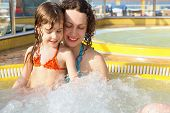 image of cruise ship  - beautiful woman with her daughter is relaxing in hot tub on cruise ship - JPG