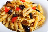 stock photo of black-cherry  - Penne with cherry tomatos and black olives fried with fresh herbs - JPG