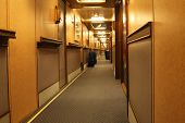 Corridor In Cruise Liner With Doors To Cabins And Sections For Luggage