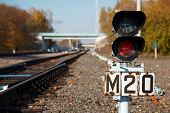 foto of train track  - Traffic light shows red signal on railway - JPG