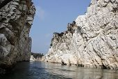 stock photo of spectacles  - Awesome spectacle of Marble Rocks during boat cruise on River Narmada in Bedaghat near Jabalpur Madhya Pradesh India Asia - JPG