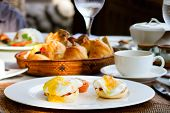 pic of benediction  - Delicious eggs Benedict served outdoors for breakfast - JPG