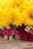 image of mums  - Bunch of mum flowers on wooden table - JPG