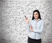 picture of math  - Portrait of smiling woman who points out complicated math calculations - JPG