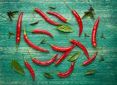 foto of spice  - Red Hot Chili Peppers with herbs and spices over wooden background  - JPG