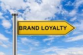 stock photo of loyalty  - brand loyalty words on yellow road sign on blue sky - JPG