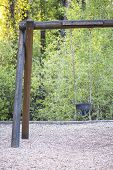 picture of swingset  - Vintage log timber swing set with empty chain - JPG