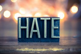 image of hate  - The word HATE written in vintage metal letterpress type on a soft backlit background - JPG