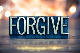 picture of forgiveness  - The word FORGIVE written in vintage metal letterpress type on a soft backlit background - JPG