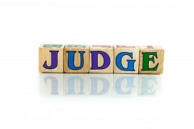 stock photo of umpire  - judge colorful wooden word block on the white background - JPG