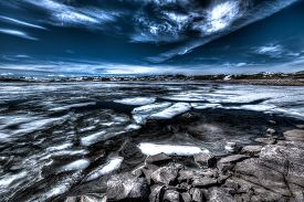 picture of plateau  - Frozen lake in winter along the road Hardangervidda Plateau under a stormy sky by night Landscape Norway. ** Note: Visible grain at 100%, best at smaller sizes - JPG