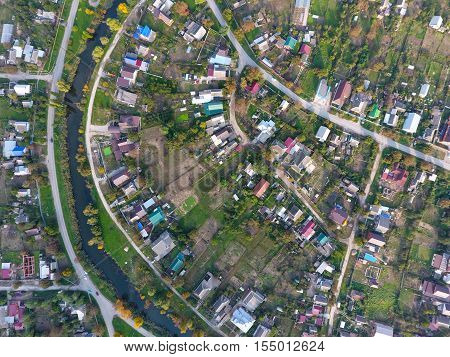 Top View Of The Village. One Can See The Roofs Of The Houses And Gardens. Road And Water In The Vill