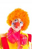 A Girl Dressed As A Clown Is Looking Up