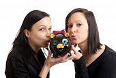 Two Young Women Piggy Bank Kissing
