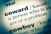 Close Up Of Old English Dictionary Page With Word Coward poster