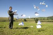 Business concept with paperwork flying everywhere!